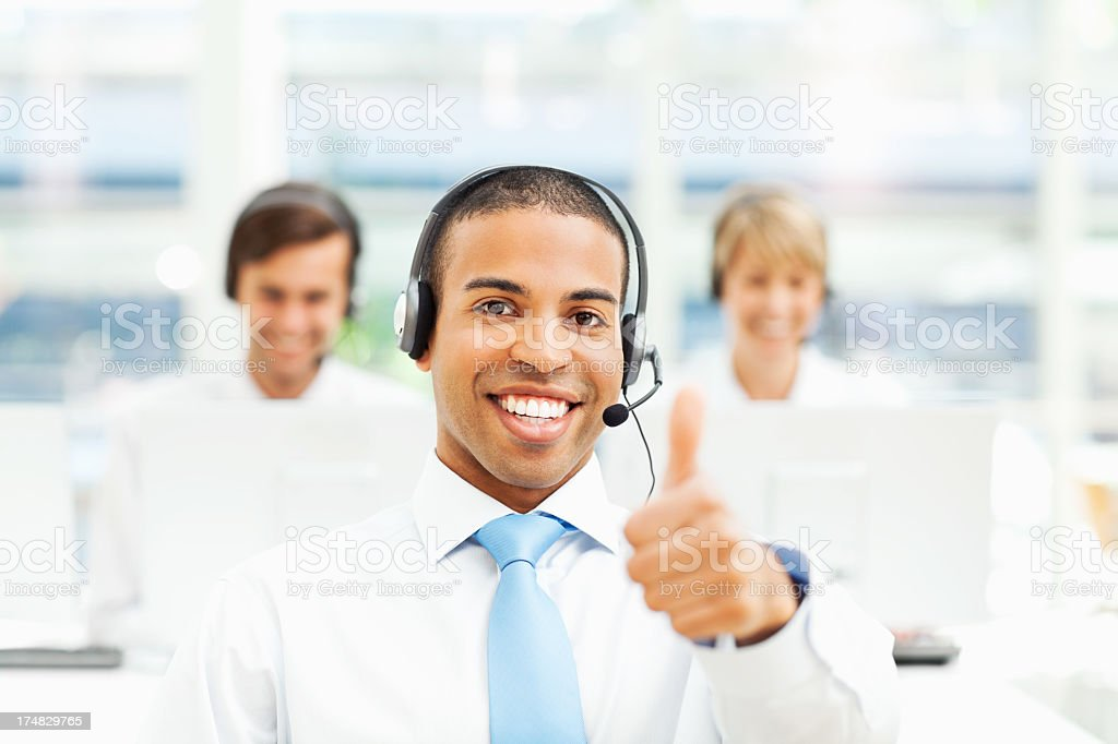 Male Customer Service Operator Gesturing Thumbs Up royalty-free stock photo