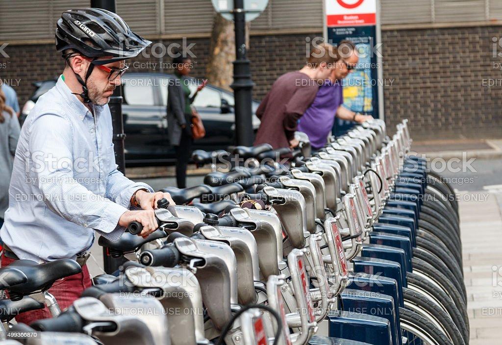 Male cyclist rents a Santander rental Boris bike stock photo
