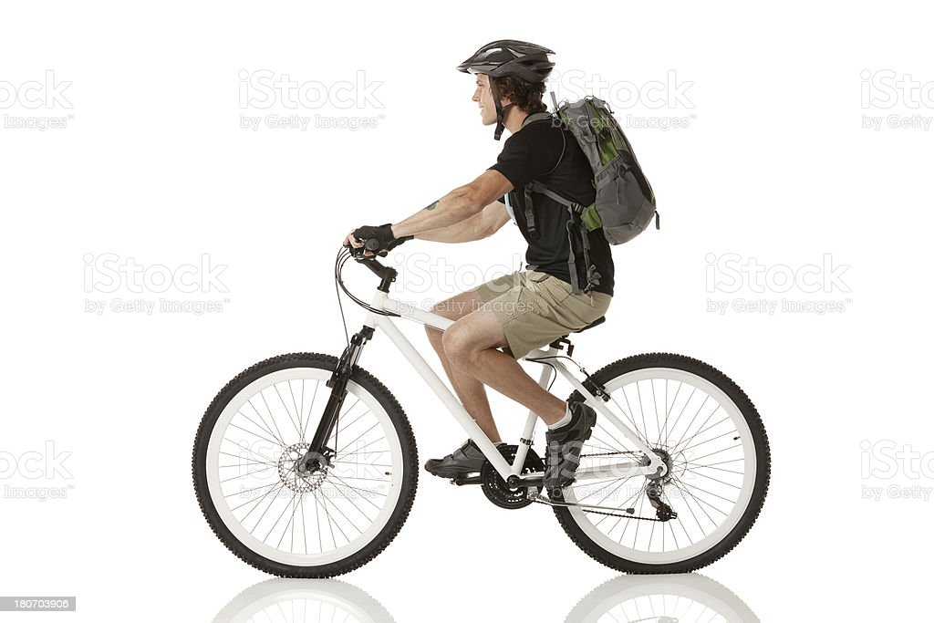 Male cyclist riding a bicycle stock photo