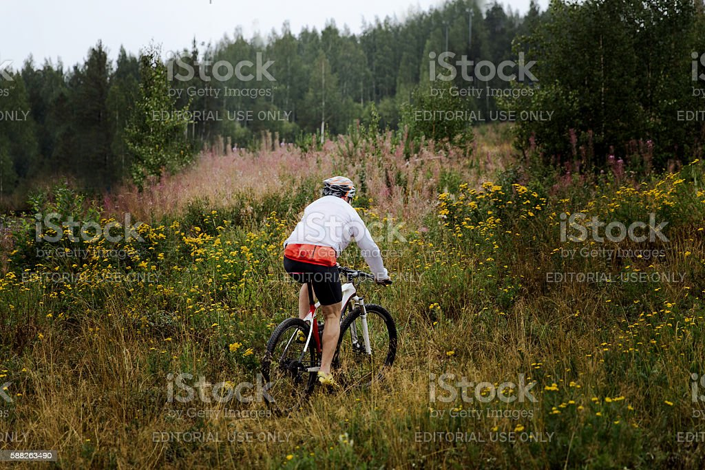 male cyclist riding across field royalty-free 스톡 사진
