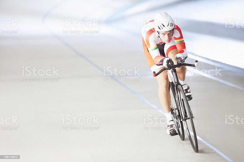 Male cyclist riding bike stock photo