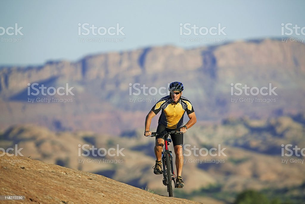 Male Cyclist Riding Mountain Bike On Slick Rock Trail royalty-free stock photo