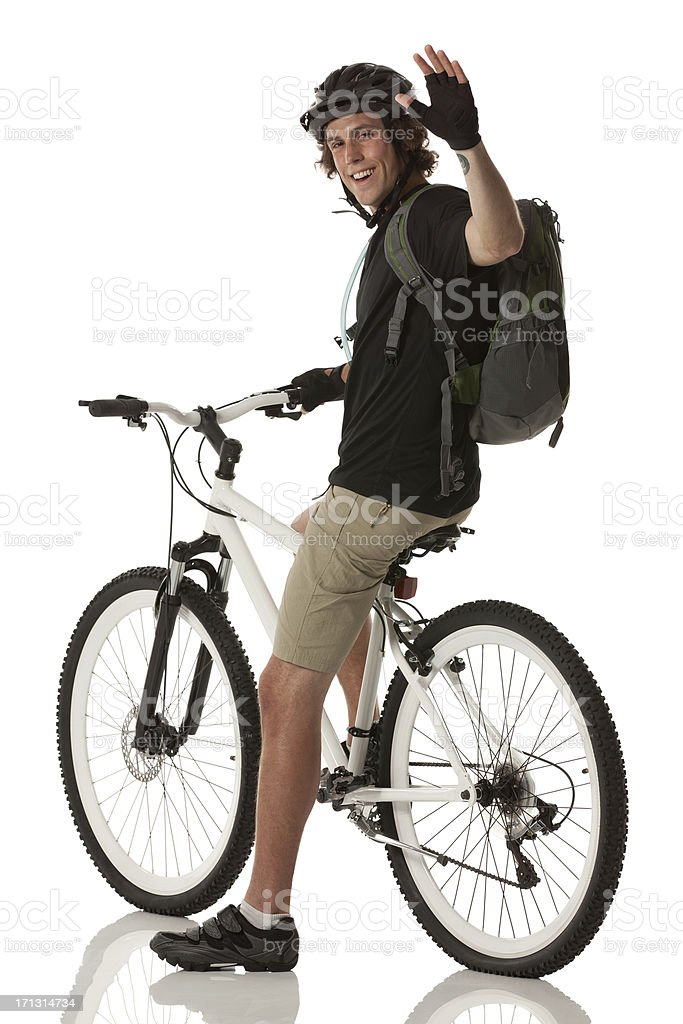 Male cyclist waving his hand royalty-free stock photo
