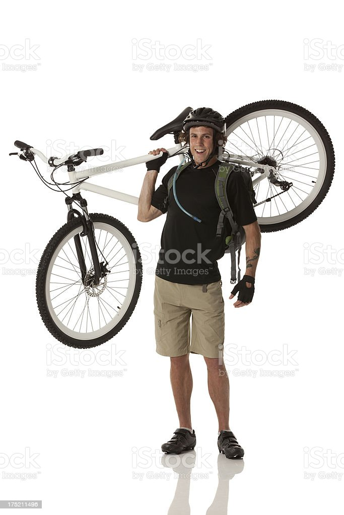 Male cyclists carrying his bicycle royalty-free stock photo