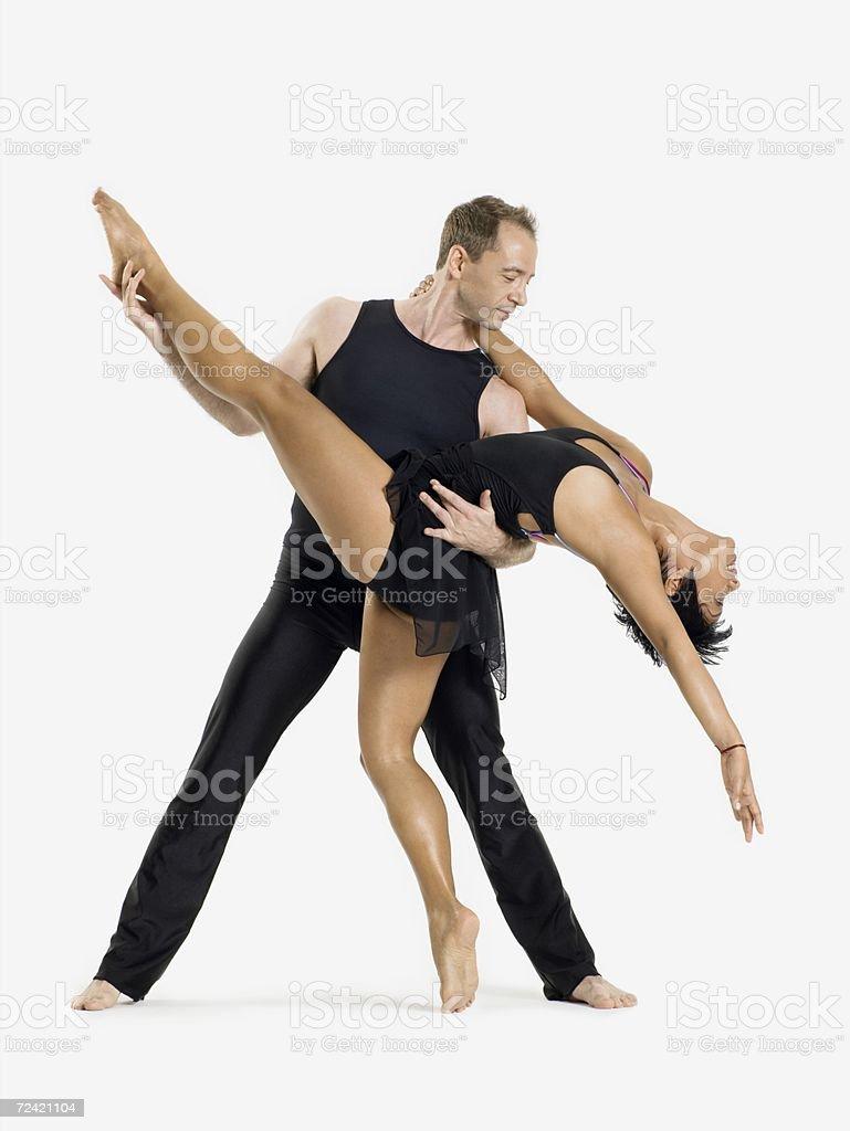 Male dancer holding female dancer stock photo