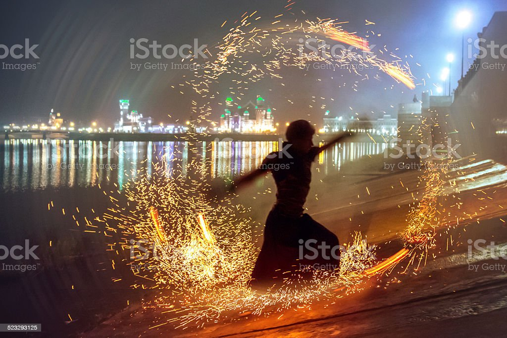 Male dancer silhouette in circle of sparks stock photo