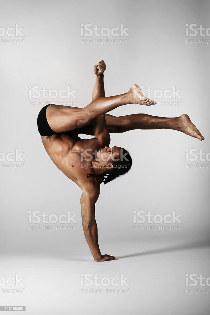 A male dancer standing on one hand royalty-free stock photo