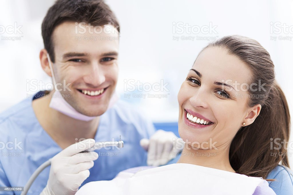 Male dentist and woman patient stock photo