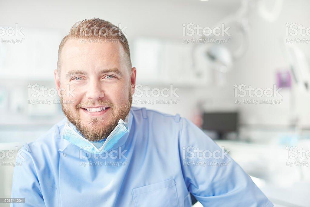 male dentist portrait stock photo