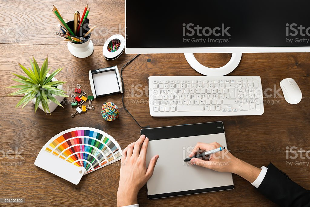 Male Designer Using Digital Graphic Tablet stock photo