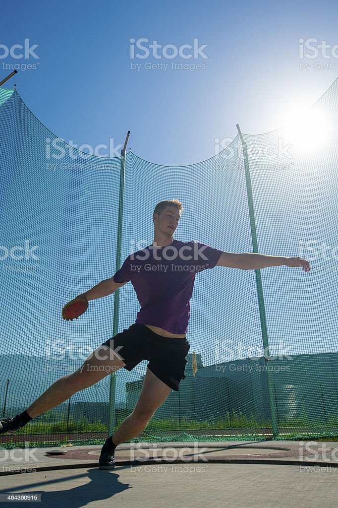Male discus thrower in the action royalty-free stock photo