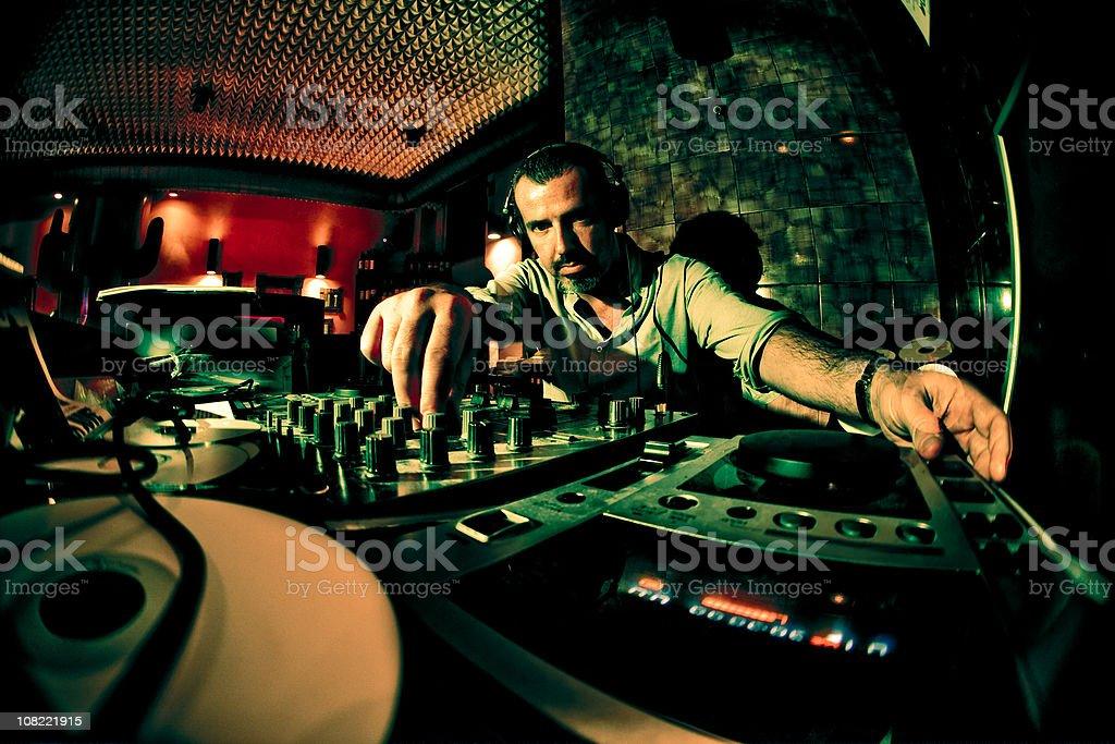 Male DJ in Nightclub, Low Key stock photo
