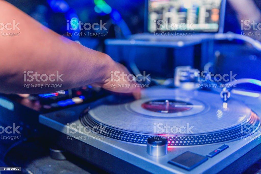 Male Dj spinning music record stock photo