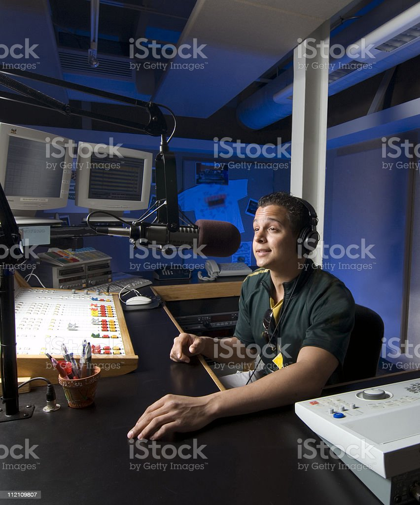 Male do working on sound cabin with green t-shirt stock photo
