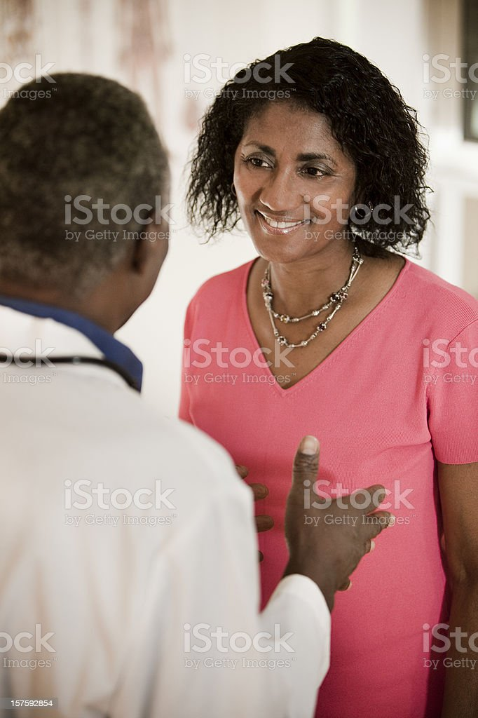 Male Doctor and Female Patient royalty-free stock photo