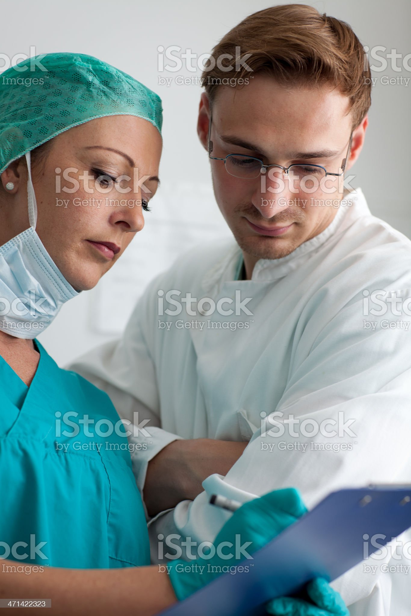 male doctor and nurse looking into patient prescription royalty-free stock photo