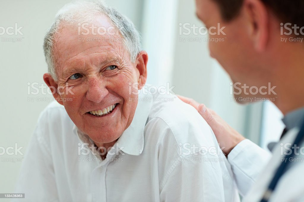 Male doctor discussing with his patient stock photo