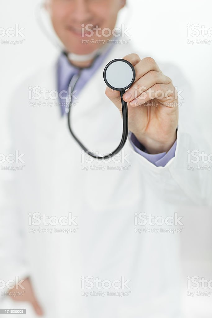 Male doctor holding stethoscope royalty-free stock photo