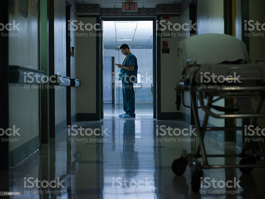 Male doctor in hospital corridor stock photo