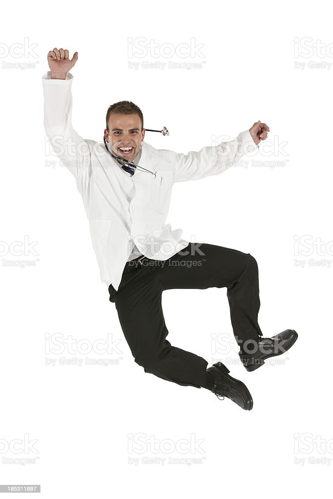 Male doctor jumping in excitement stock photo