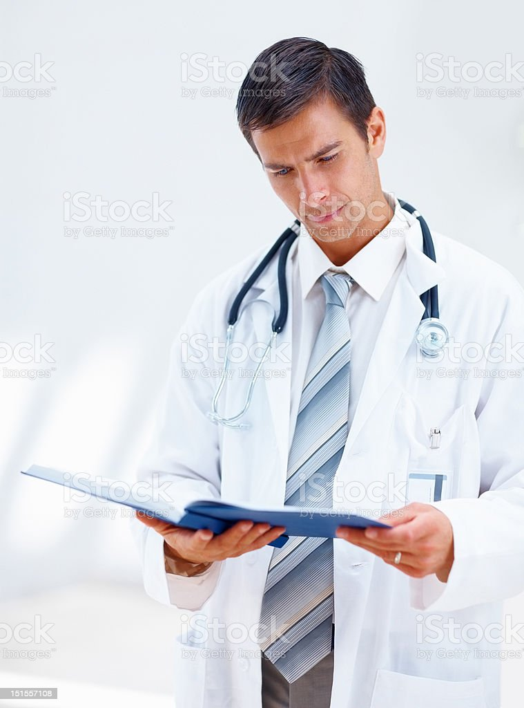 Male doctor looking at the reports royalty-free stock photo