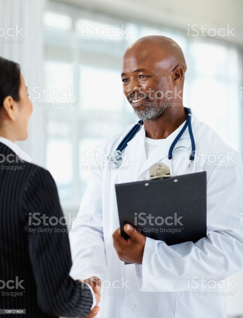 Male doctor shaking hand with his colleague royalty-free stock photo