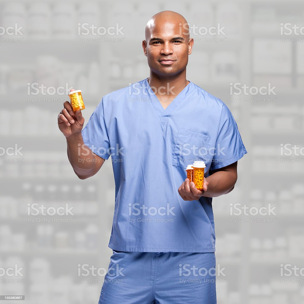 Male Doctor Showing Medicine Bottles royalty-free stock photo