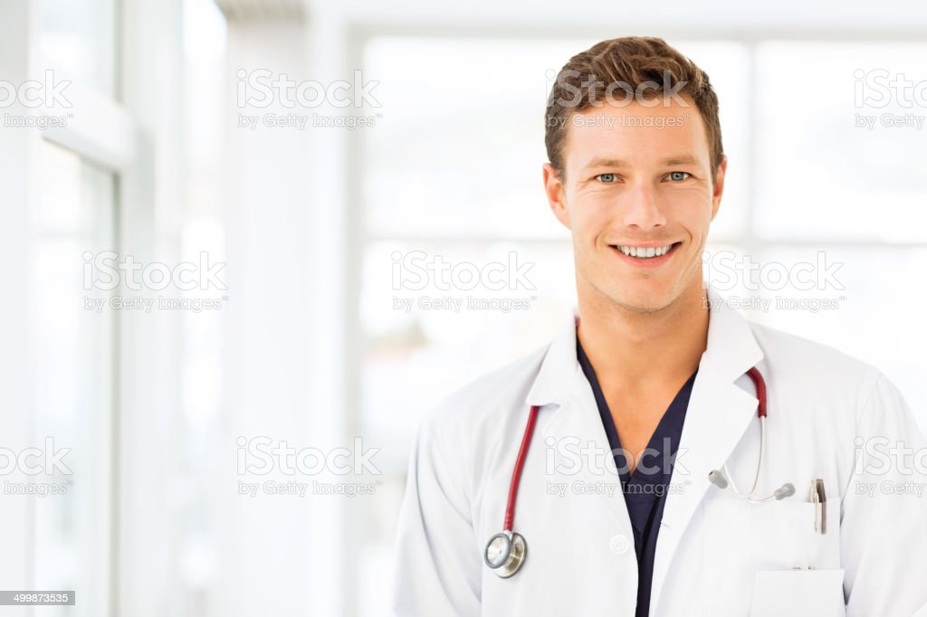 Male Doctor Smiling In Hospital stock photo