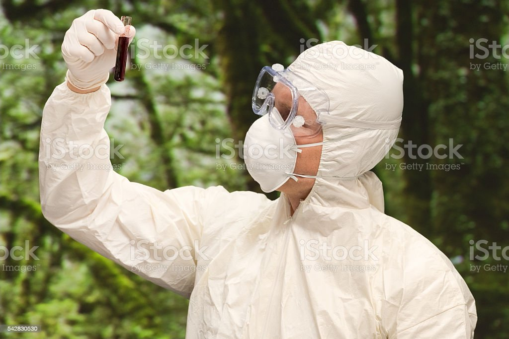 Male doctor testing blood with test tube stock photo