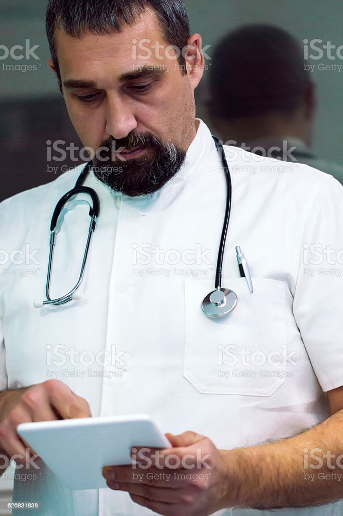 Male doctor using digital tablet stock photo