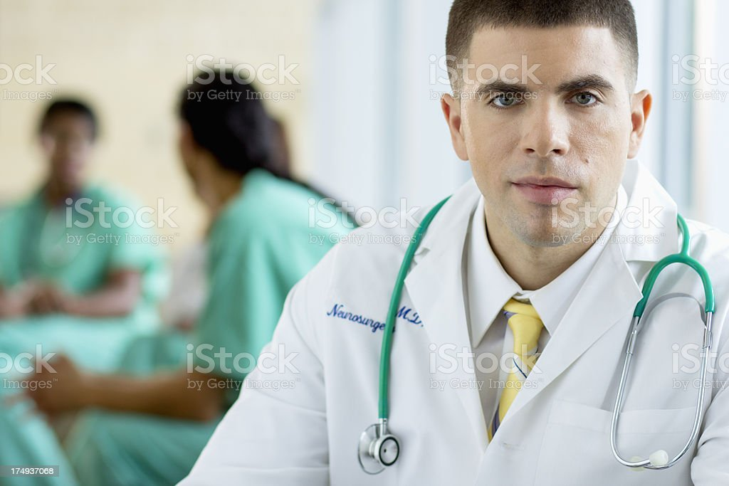Male Doctor with a stethoscope around his neck stock photo