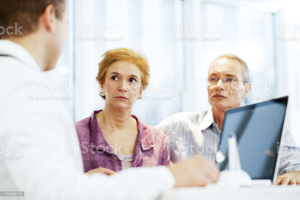 Male doctor with his mature couple patient royalty-free stock photo