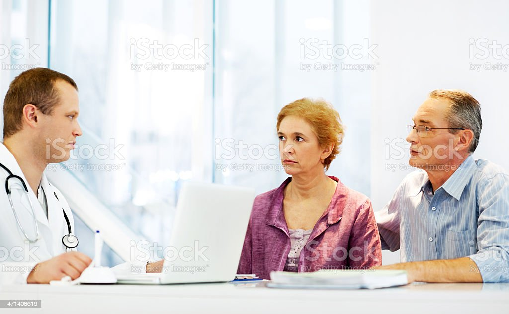 Male doctor with his mature couple patient. royalty-free stock photo