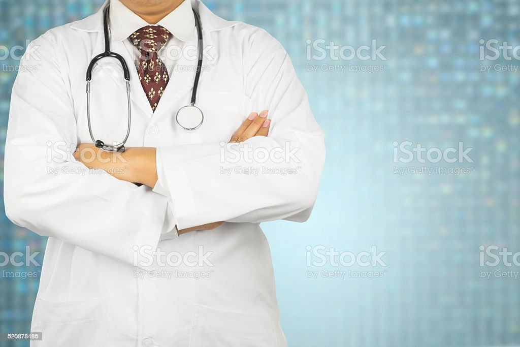 Male doctor working with stethoscope stock photo