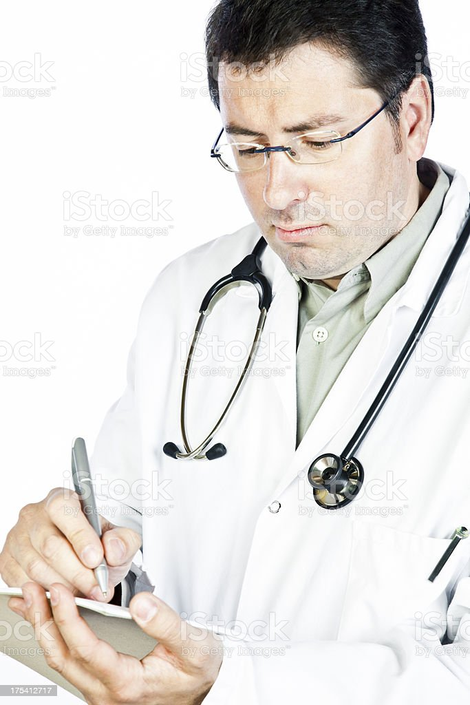 Male doctor writing on a document royalty-free stock photo