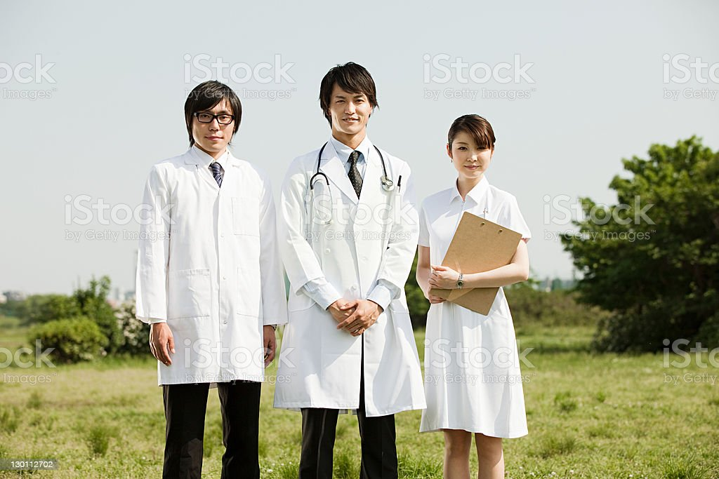 Male doctors and female nurse, portrait stock photo