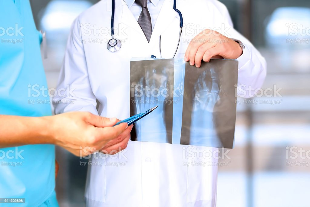 Male doctors looking at x-ray of foot stock photo