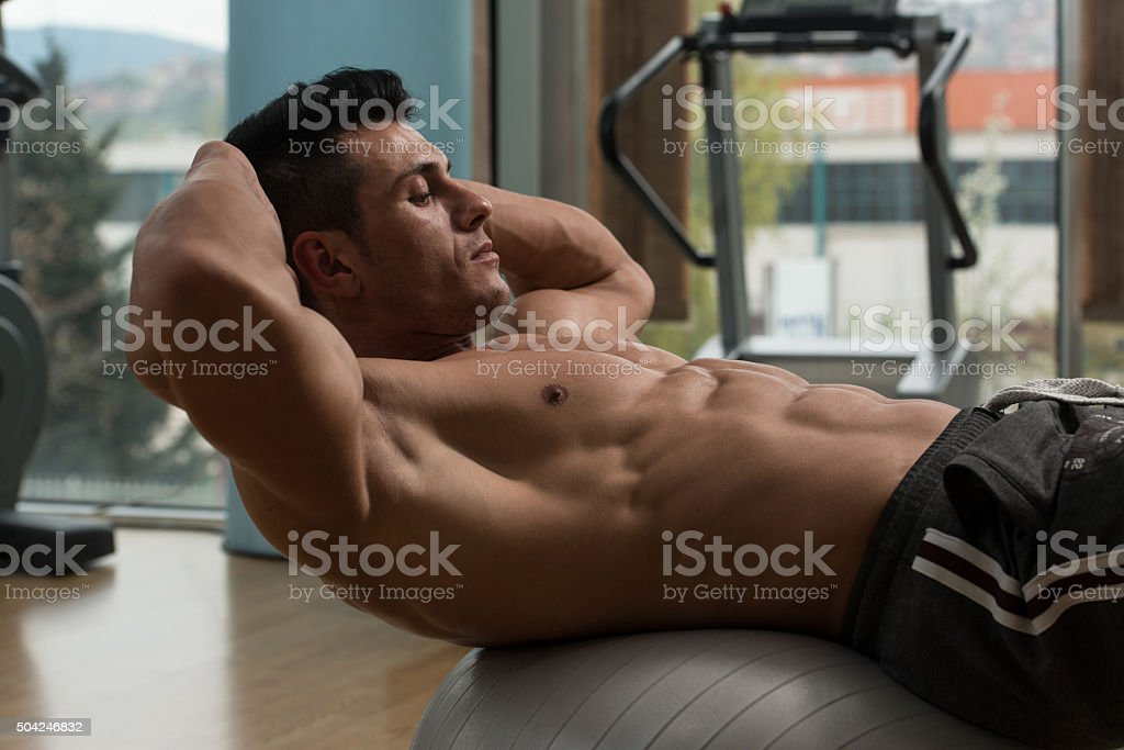 Male Doing Push-Ups In A Gym stock photo