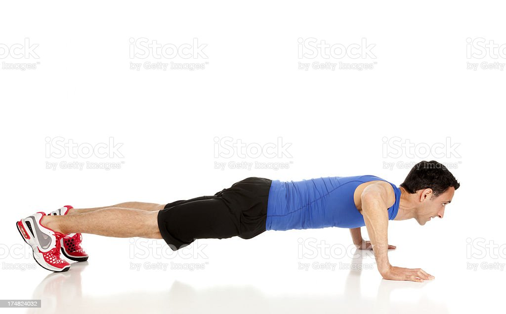 Male doing Push-ups isolated on white stock photo