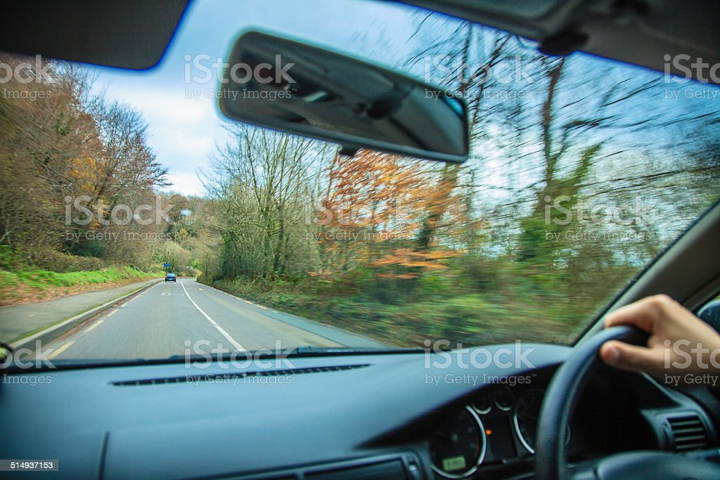 Male driver hands on steering wheel of a car stock photo