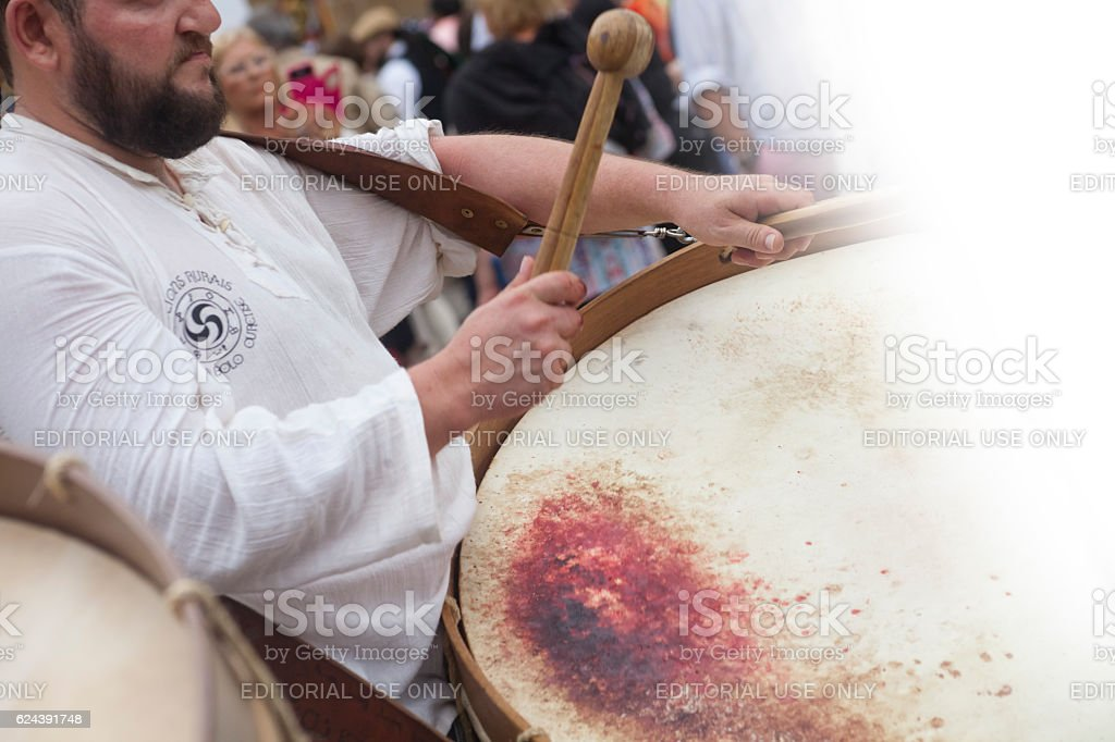 Male drummer in a street band, blood on drum skin stock photo