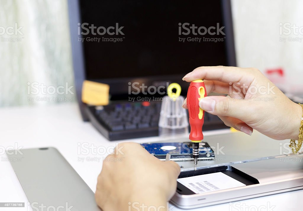 Male during repair his laptop stock photo