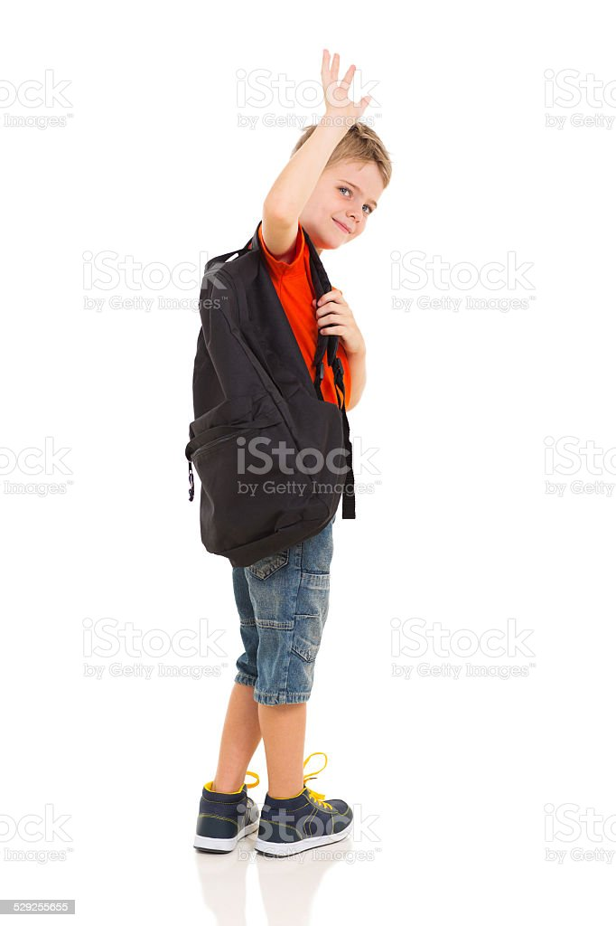 male elementary school student waving goodbye stock photo