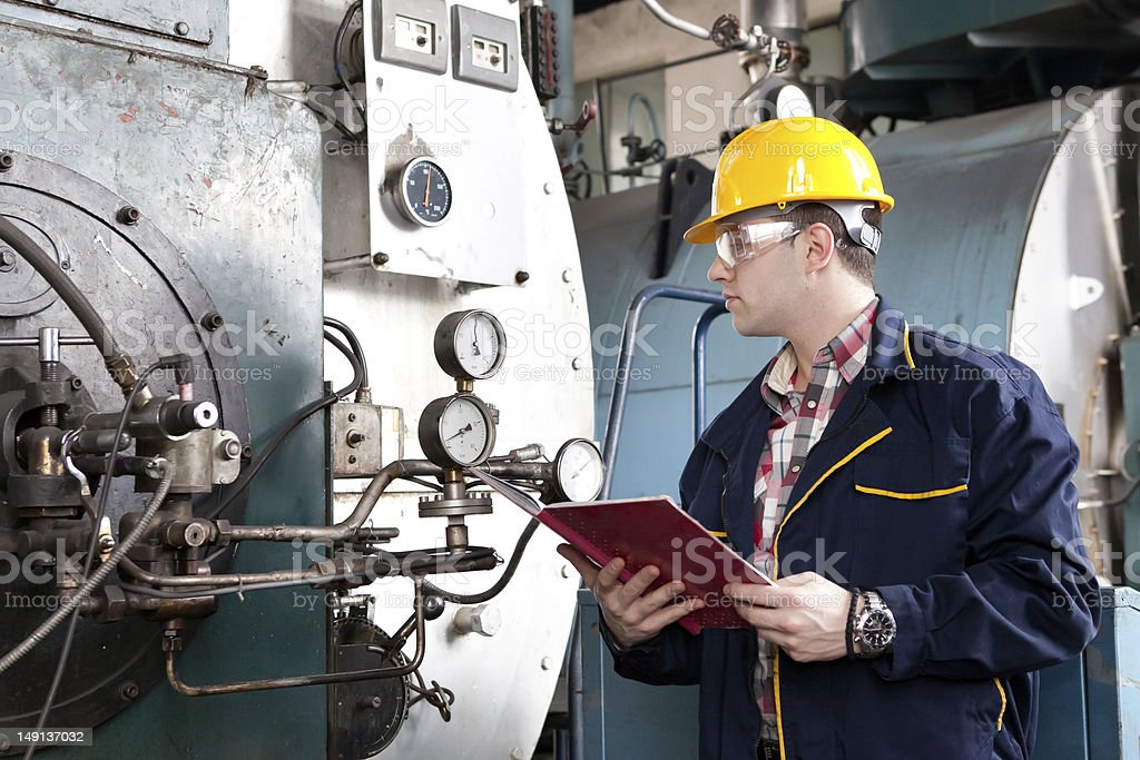 Male engineer at work with clipboard stock photo
