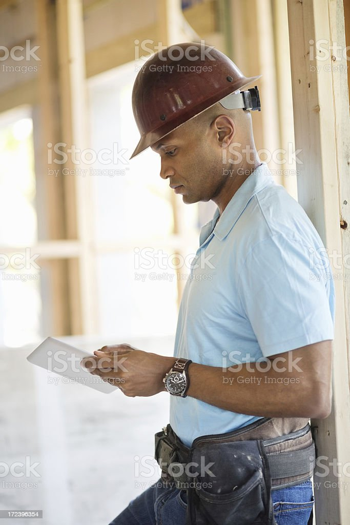 Male Engineer Using Digital Tablet At Construction Site royalty-free stock photo