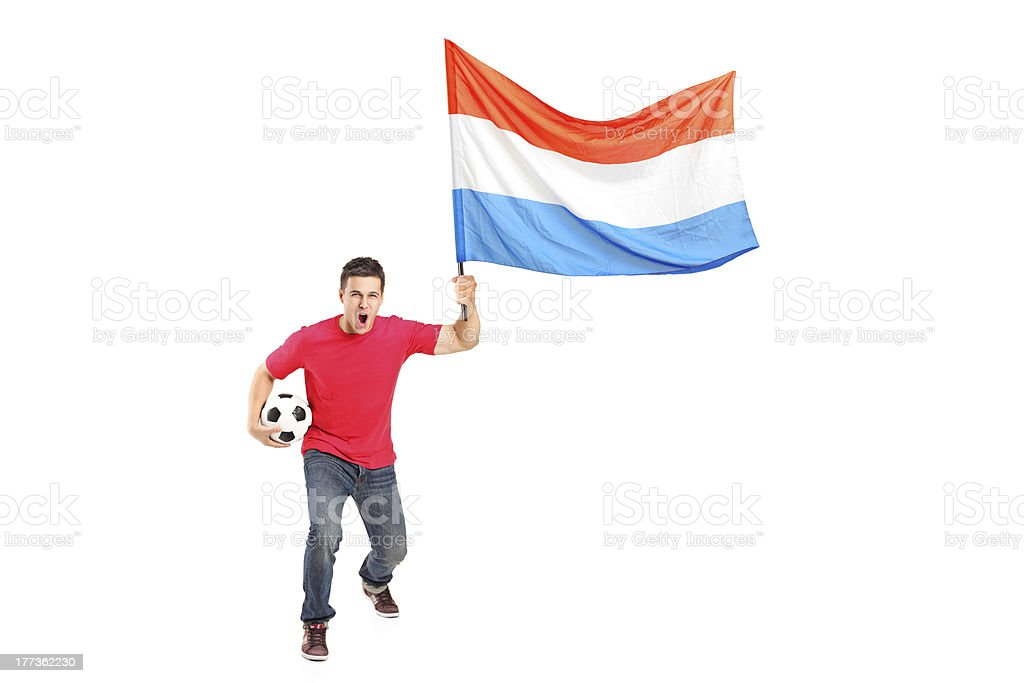 Male euphoric fan holding a football and dutch flag royalty-free stock photo