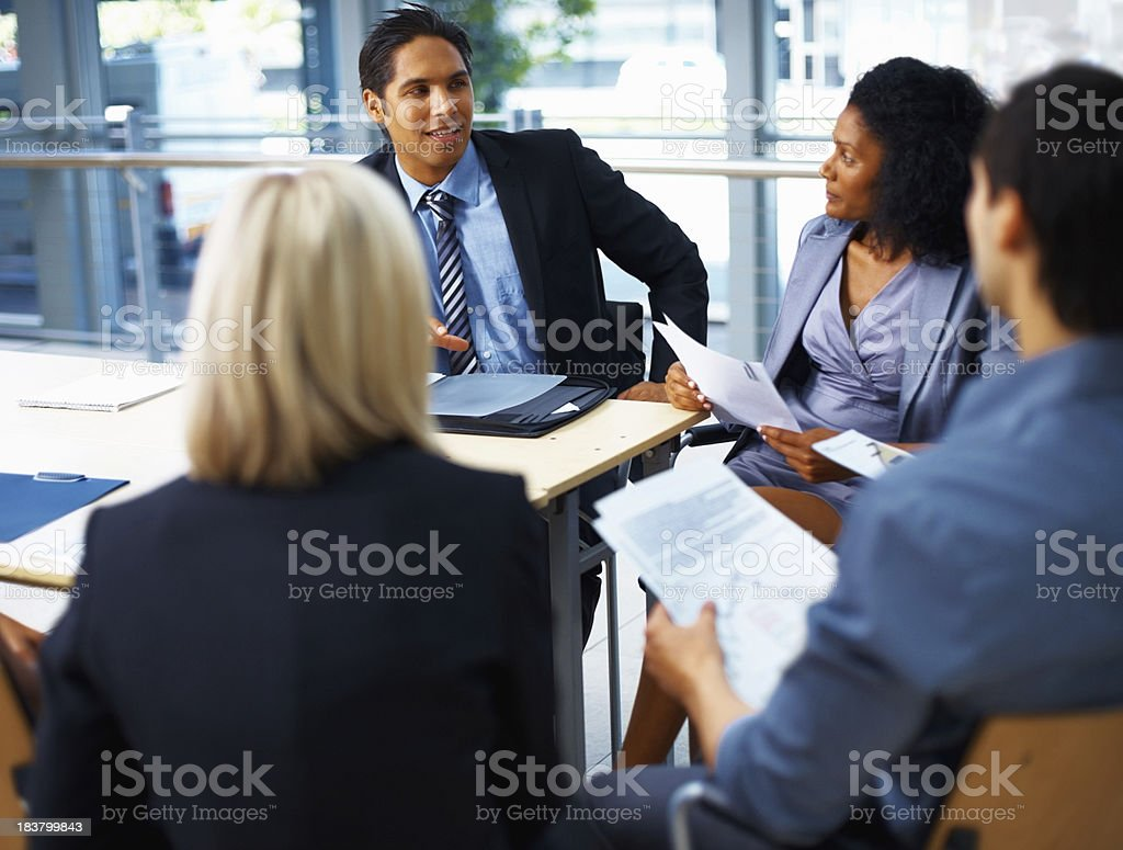 Male executive communicating with team royalty-free stock photo