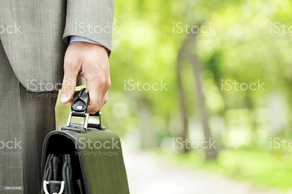Male Executive Holding Briefcase stock photo
