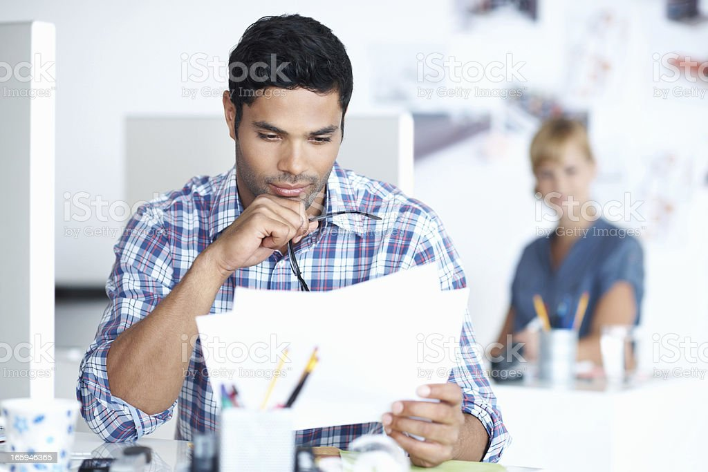 Male executive reading documents royalty-free stock photo