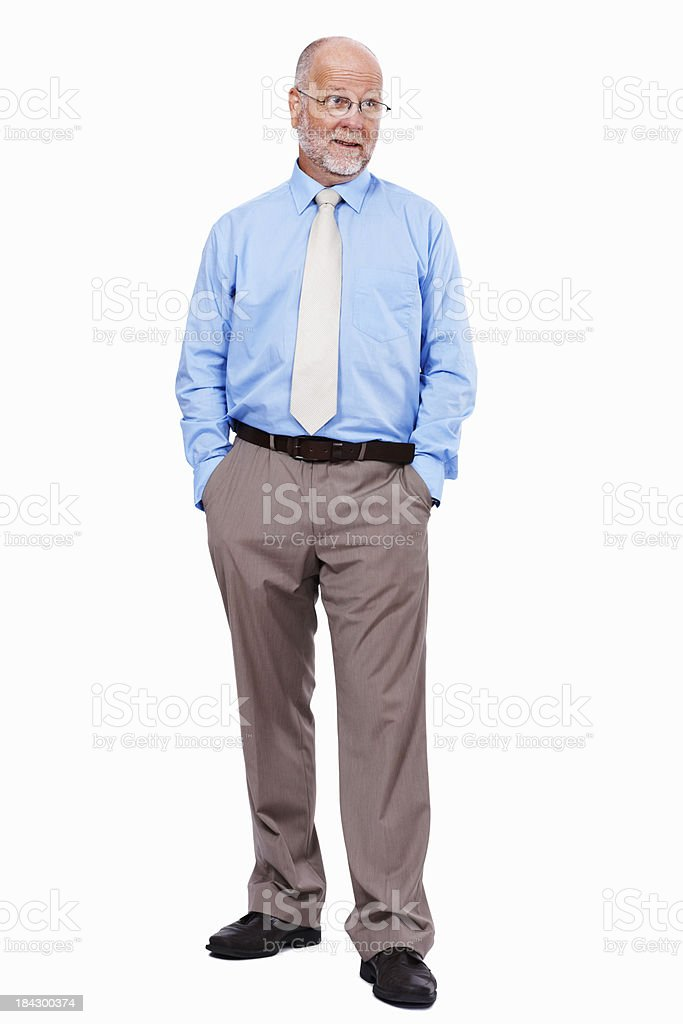 Male executive standing with hands in pockets royalty-free stock photo